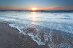 Gold sunset over North sea beach royalty free stock image