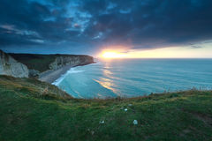 Gold sunshine over ocean in Normandy Royalty Free Stock Images