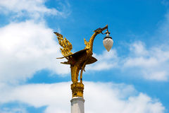 Gold swan bird on pole Stock Images
