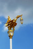 Gold swan bird on pole and sky Stock Images