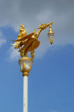 Gold swan bird on pole and sky Stock Photos