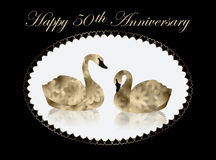 """Gold Swans in White Oval, 50th Anniversary Card. Pair of beautiful gold and black """"flower"""" swans facing each other as they float on a white lake of water Stock Photography"""