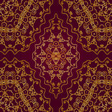 Gold swirls on a red background. Seamless pattern of gold swirls on a red background Royalty Free Stock Images
