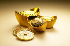 Gold Sycee ingot. Old Chinese style Gold Sycee ingot with yellow background stock photo