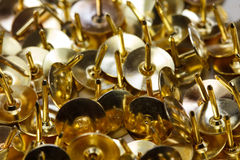 Gold tacks Royalty Free Stock Photography