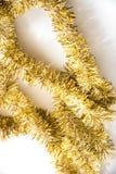 Gold tassel on white Royalty Free Stock Photo