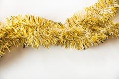 Gold tassel on white Stock Photos