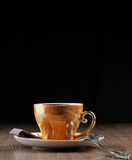 Gold Tea cup with spoon Stock Images