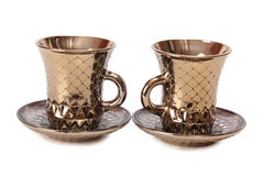 Gold tea cups two Stock Photos