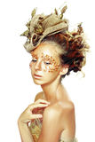 Gold Teen Fashion Girl. Luxury Golden Makeup. Beautiful Professional Holiday Make-up. Gold Teen Fashion Girl. Fashion Art Portrait Stock Photo