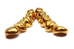 Gold teeth. This are gold crowns for teeth Stock Photography