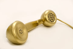 The gold telephone. Royalty Free Stock Photo