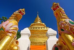 Gold temple 2. The temple can be dated back to the mid-1400s and houses a collection of bronze Buddha images while the secondary chapel contains a holy Buddha royalty free stock photo