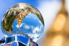 Gold temple reflecting in crystal ball Stock Images
