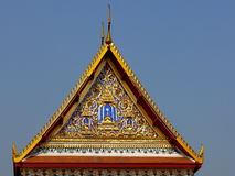 Gold temple roof in Bangkok, Thailand. Ornate gold gilded temple roof in Bangkok, Thailand Royalty Free Stock Images
