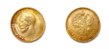 Gold ten rubles coin. Ten rubles - old golden coin from Russia with a portrait of Nicholas II. The text on the obverse says & x22;Nicholas the Second emperor of Stock Image