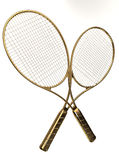 Gold tennis rackets. Two modern tennis racquets, with carbon fiber-reinforced polymer frame Royalty Free Stock Image