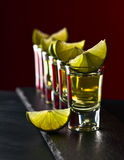 Gold tequila with lime Stock Images