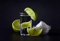 Gold tequila and lime stock photo