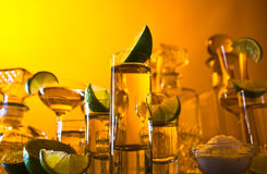 Gold tequila and lime Royalty Free Stock Images