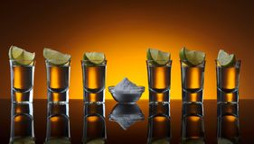 Gold tequila , lime and salt . royalty free stock photo