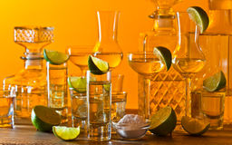 Gold tequila and lime Stock Photography