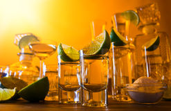 Gold tequila and lime Stock Images