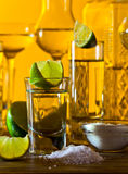 Gold tequila and lime Stock Photos