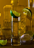 Gold tequila and lime Royalty Free Stock Image