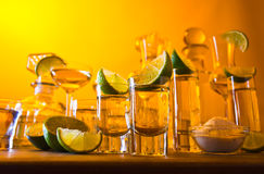 Gold tequila and lime Stock Image