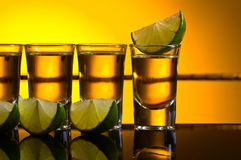 Gold Tequila with lime . stock images