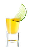 Gold Tequila with lime slice Royalty Free Stock Images