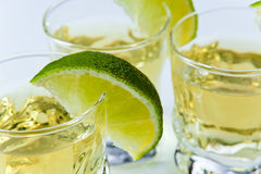 Gold tequila with lime Royalty Free Stock Image