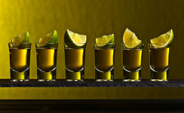 Gold tequila with lime Royalty Free Stock Images