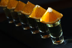 Gold tequila with orange Royalty Free Stock Images