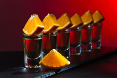 Gold tequila with orange Stock Images