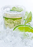 Gold tequila with salt and lime Royalty Free Stock Photography