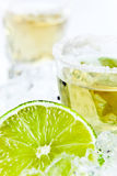 Gold tequila with salt and lime Royalty Free Stock Photos