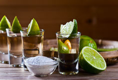Gold tequila with salt and lime Royalty Free Stock Image