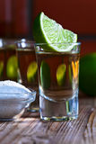 Gold tequila with salt and lime Stock Image