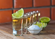 Gold tequila with salt and lime Stock Images