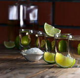 Gold tequila with salt and lime Royalty Free Stock Photo