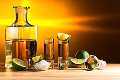 Gold tequila with salt and lime Royalty Free Stock Images