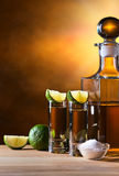 Gold tequila with salt and lime Stock Photography