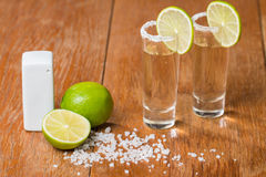 Gold Tequila in Shot Glasses with Lime and Salt Stock Images