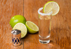 Gold Tequila in Shot Glasses with Lime and Salt Royalty Free Stock Photography