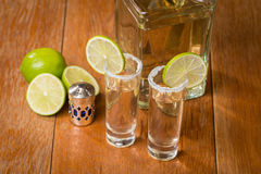 Gold Tequila in Shot Glasses with Lime and Salt Stock Image