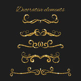 Gold text dividers set. Ornamental decorative elements.. Text dividers set with gold. Ornamental decorative elements. Vector ornate design. Golden flourishes Stock Images