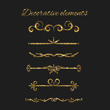 Gold text dividers set. Ornamental decorative elements.  Stock Image