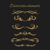 Gold text dividers set. Ornamental decorative elements. Stock Photos